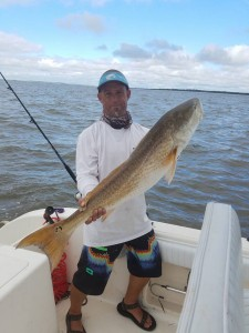 Capt. Eric Norberg with bull redfish